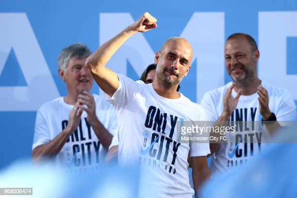 Josep Guardiola Manager of Manchester City acknowledge the fans from the stage during the Manchester City Trophy Parade on May 14 2018 in Manchester...