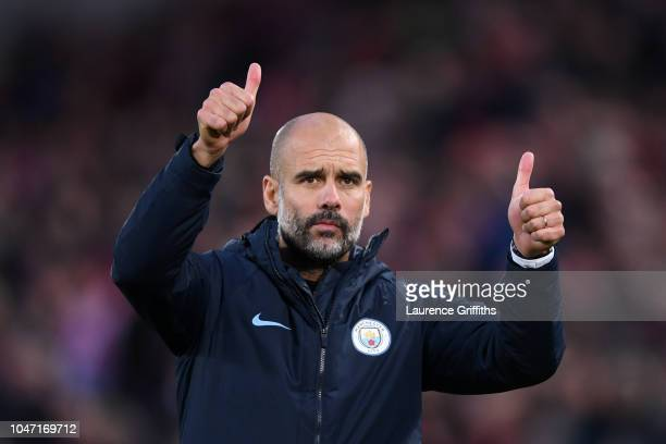 Josep Guardiola Manager of Manchester City acknowledges the fans after the Premier League match between Liverpool FC and Manchester City at Anfield...