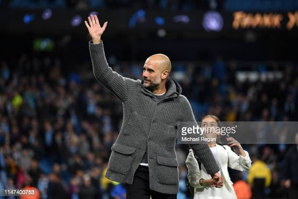 Josep Guardiola Manager of Manchester City acknowledges the fans with his daughter Valentina Guardiola during the Premier League match between...