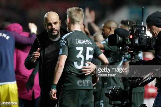 Josep Guardiola Manager of Manchester City and Alexander Zinchenko of Manchester City celebrate victory after the Carabao Cup semifinal second leg...