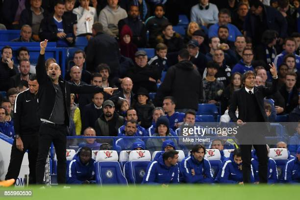 Josep Guardiola Manager of Manchester City and Antonio Conte Manager of Chelsea give their team instructions during the Premier League match between...