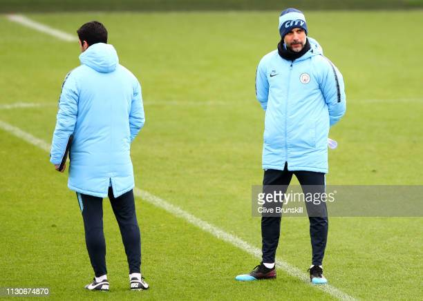 Josep Guardiola Manager of Manchester City and assistant manager Mikel Arteta look on during a Manchester City training session at Manchester City...
