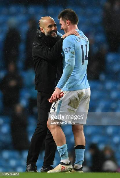 Josep Guardiola Manager of Manchester City and Aymeric Laporte of Manchester City celebrate victory after the Premier League match between Manchester...
