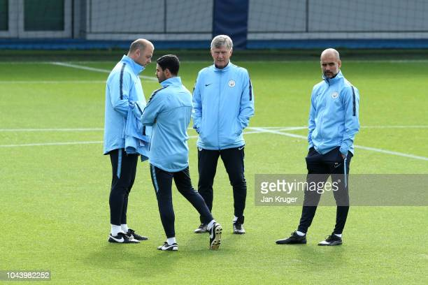 Josep Guardiola Manager of Manchester City and his backroom staff looks on during a training session ahead of their Group F match against TSG...