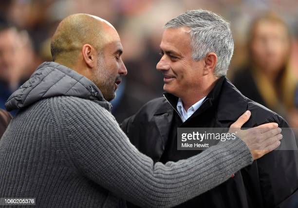 Josep Guardiola Manager of Manchester City and Jose Mourinho Manager of Manchester United embrace prior to the Premier League match between...