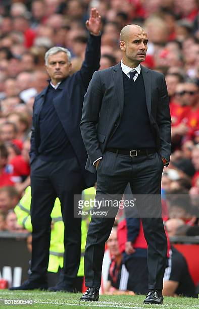 Josep Guardiola Manager of Manchester City and Jose Mourinho Manager of Manchester United look on during the Premier League match between Manchester...