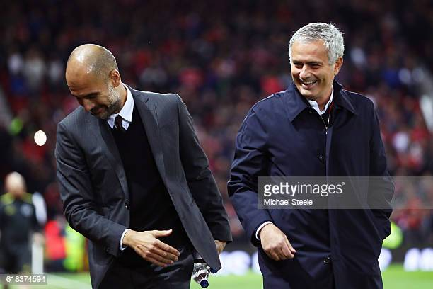 Josep Guardiola Manager of Manchester City and Jose Mourinho Manager of Manchester United share a joke prior to kick off during the EFL Cup fourth...