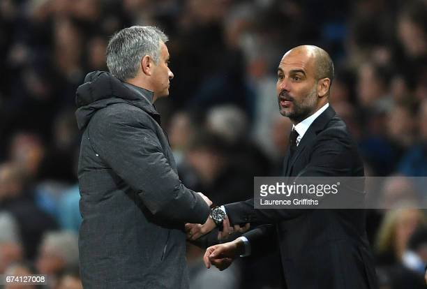 Josep Guardiola Manager of Manchester City and Jose Mourinho Manager of Manchester United shake hands after the full time whistle during the Premier...