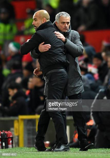 Josep Guardiola Manager of Manchester City and Jose Mourinho Manager of Manchester United react after the Premier League match between Manchester...