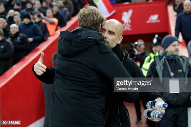 Josep Guardiola Manager of Manchester City and Jurgen Klopp Manager of Liverpool hug each other before the Premier League match between Liverpool and...