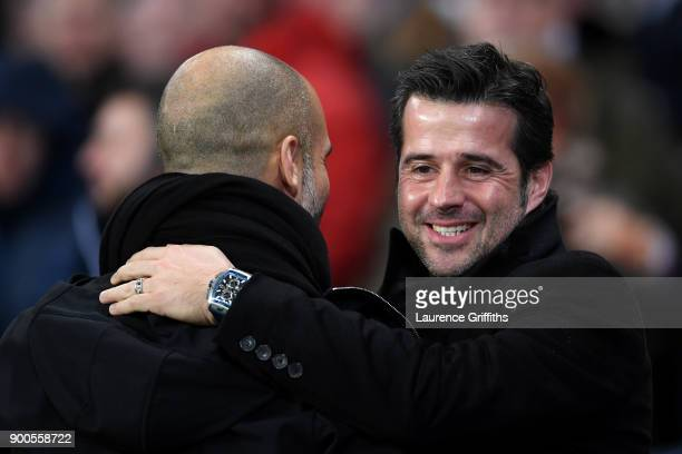 Josep Guardiola Manager of Manchester City and Marco Silva Manager of Watford embrace prior to the Premier League match between Manchester City and...