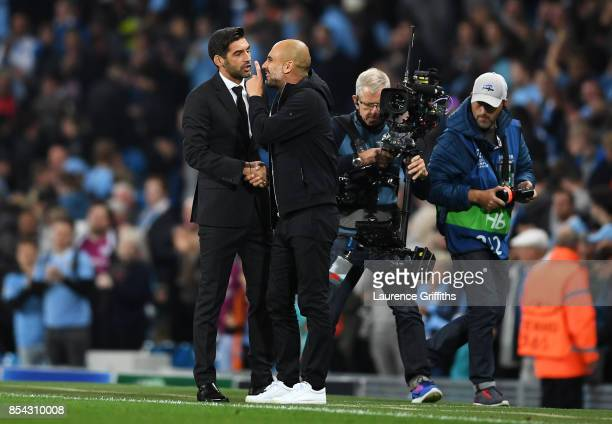 Josep Guardiola Manager of Manchester City and Paulo Fonseca Manager of Shakhtar Donetsk speak during the UEFA Champions League Group F match between...