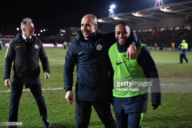 Josep Guardiola Manager of Manchester City and Raheem Sterling of Manchester City celebrate following their sides victory in during the FA Cup Fifth...