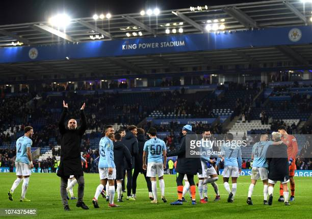 Josep Guardiola Manager of Manchester City applauds fans after his team win the penalty shoot out during the Carabao Cup Quarter Final match between...