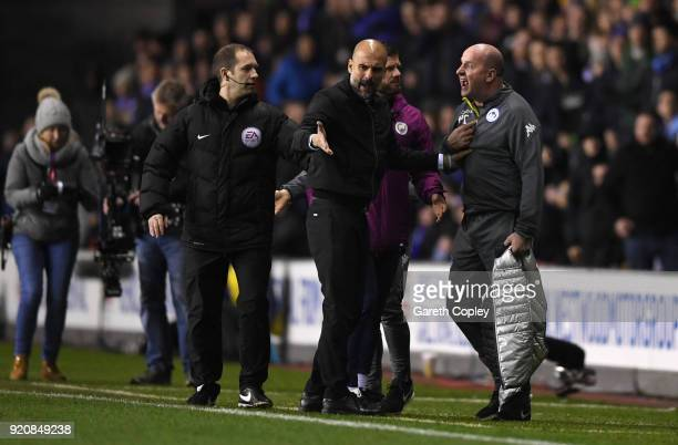 Josep Guardiola Manager of Manchester City argues with Paul Cook Manager of Wigan Athletic during the Emirates FA Cup Fifth Round match between Wigan...