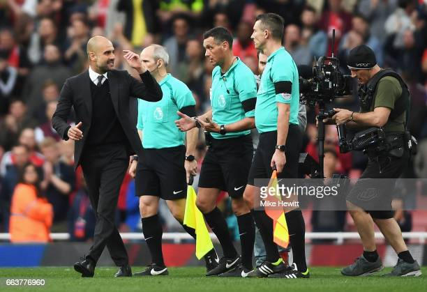 Josep Guardiola Manager of Manchester City argues with referee Andre Marriner after the Premier League match between Arsenal and Manchester City at...