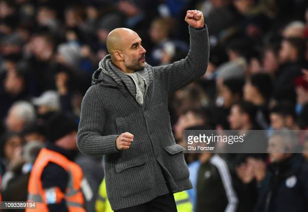 Josep Guardiola Manager of Manchester City celebrates as Sergio Aguero of Manchester City scores his team's second goal during the Premier League...
