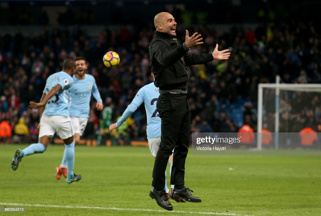 Josep Guardiola, Manager of Manchester City celebrates during the Premier League match between Manchester City and Southampton at Etihad Stadium on November 29, 2017 in Manchester, England.