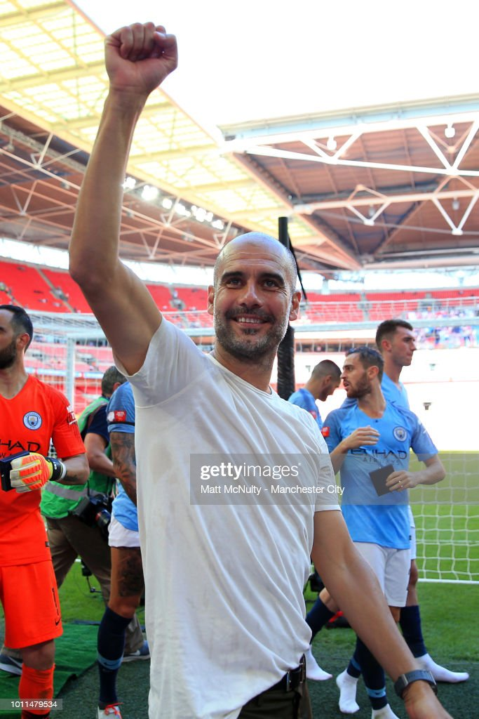 Josep Guardiola, Manager of Manchester City celebrates following his sides victory in the FA Community Shield between Manchester City and Chelsea at Wembley Stadium on August 5, 2018 in London, England.