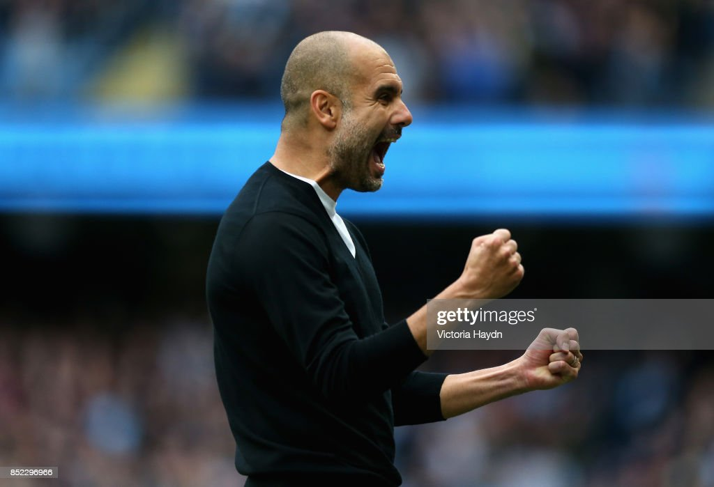 Josep Guardiola, Manager of Manchester City celebrates his sides second goal during the Premier League match between Manchester City and Crystal Palace at Etihad Stadium on September 23, 2017 in Manchester, England.