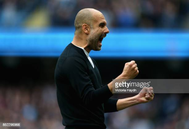 Josep Guardiola Manager of Manchester City celebrates his sides second goal during the Premier League match between Manchester City and Crystal...