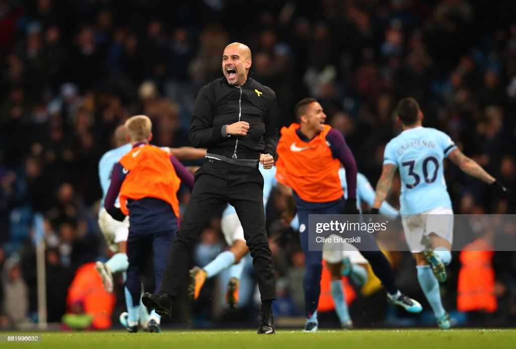 Josep Guardiola, Manager of Manchester City celebrates his sides second goal during the Premier League match between Manchester City and Southampton at Etihad Stadium on November 29, 2017 in Manchester, England.