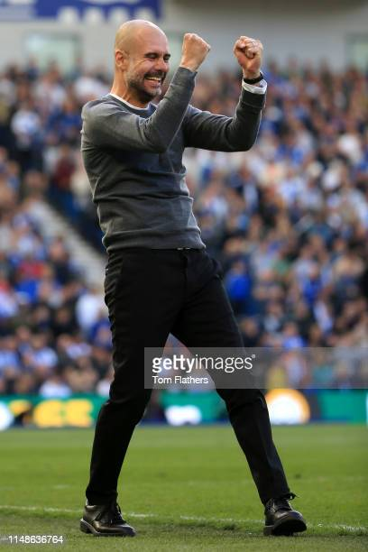 Josep Guardiola Manager of Manchester City celebrates his sides third goal during the Premier League match between Brighton Hove Albion and...