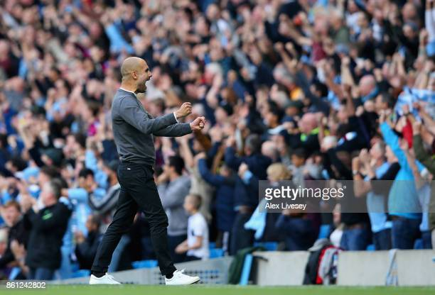 Josep Guardiola Manager of Manchester City celebrates his team's opening goal during the Premier League match between Manchester City and Stoke City...