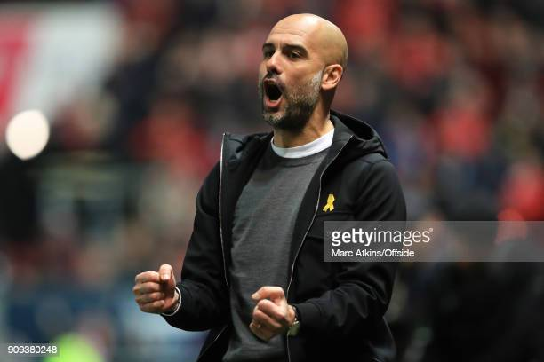 Josep Guardiola manager of Manchester City celebrates his teams late goal during the Carabao Cup SemiFinal 2nd leg match between Bristol City and...