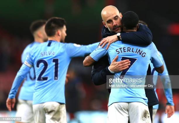 Josep Guardiola Manager of Manchester City celebrates victory with Raheem Sterling of Manchester City after the Premier League match between AFC...