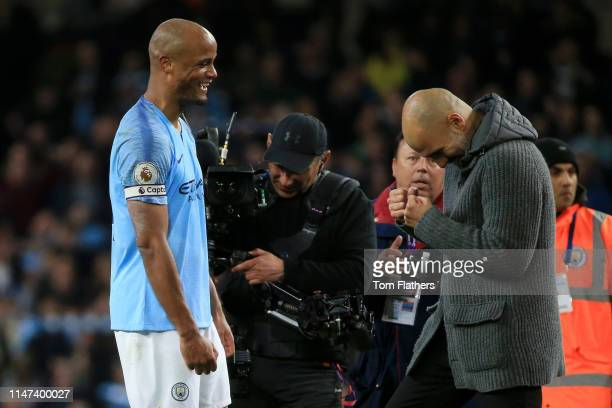 Josep Guardiola Manager of Manchester City celebrates victory with Vincent Kompany of Manchester City after the Premier League match between...