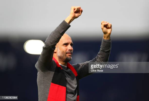 Josep Guardiola Manager of Manchester City celebrates whilst wearing a black and red scarf in memory of former club secretary Bernard Halford...