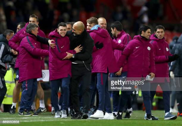 Josep Guardiola Manager of Manchester City celebrates with Phil Foden of Manchester City after the Premier League match between Manchester United and...