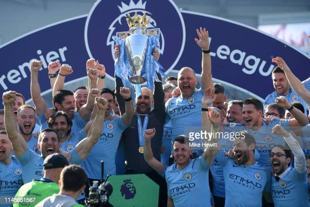 Josep Guardiola, Manager of Manchester City celebrates with the Premier League Trophy after winning the title during the Premier League match between...