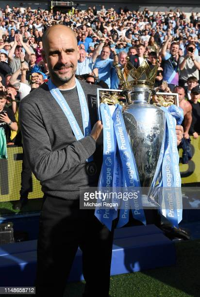 Josep Guardiola Manager of Manchester City celebrates with the Premier League Trophy after winning the title following the Premier League match...