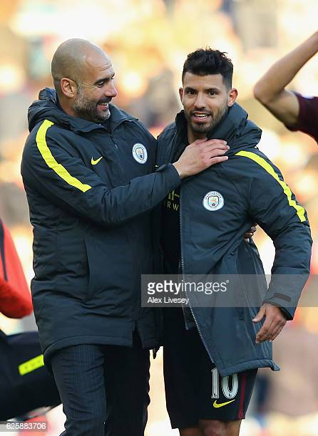 Josep Guardiola Manager of Manchester City congratulates Sergio Aguero after their 21 win in the Premier League match between Burnley and Manchester...