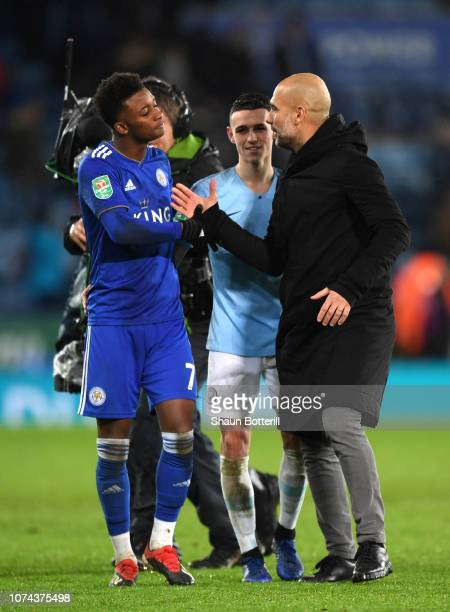 Josep Guardiola Manager of Manchester City consoles Demarai Gray of Leicester City after Manchester City win the penalty shoot out during the Carabao...