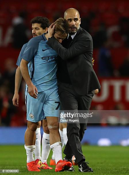 Josep Guardiola Manager of Manchester City embraces Aleix Garcia of Manchester City after the final whistle during the EFL Cup fourth round match...