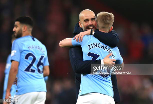 Josep Guardiola Manager of Manchester City embraces Oleksandr Zinchenko of Manchester City following the Premier League match between AFC Bournemouth...
