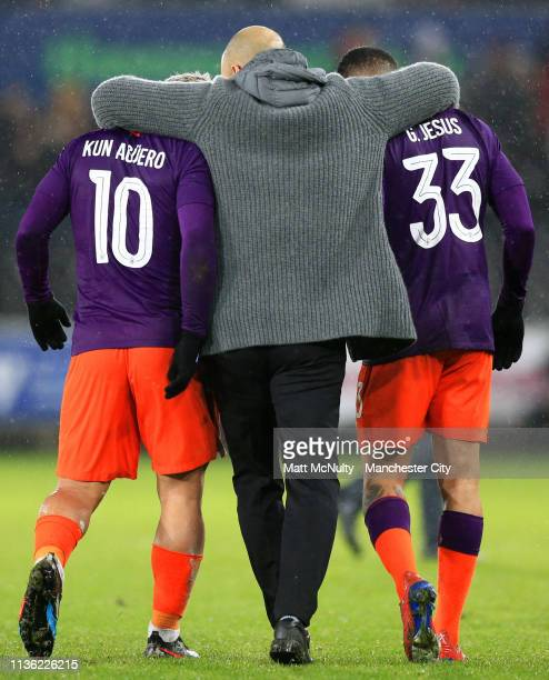 Josep Guardiola Manager of Manchester City embraces Sergio Aguero of Manchester City and Gabriel Jesus of Manchester City after the FA Cup Quarter...