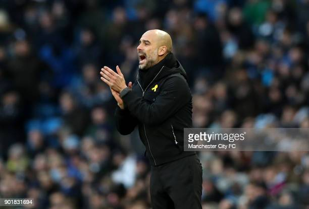 Josep Guardiola Manager of Manchester City encourages his team during The Emirates FA Cup Third Round match between Manchester City and Burnley at...