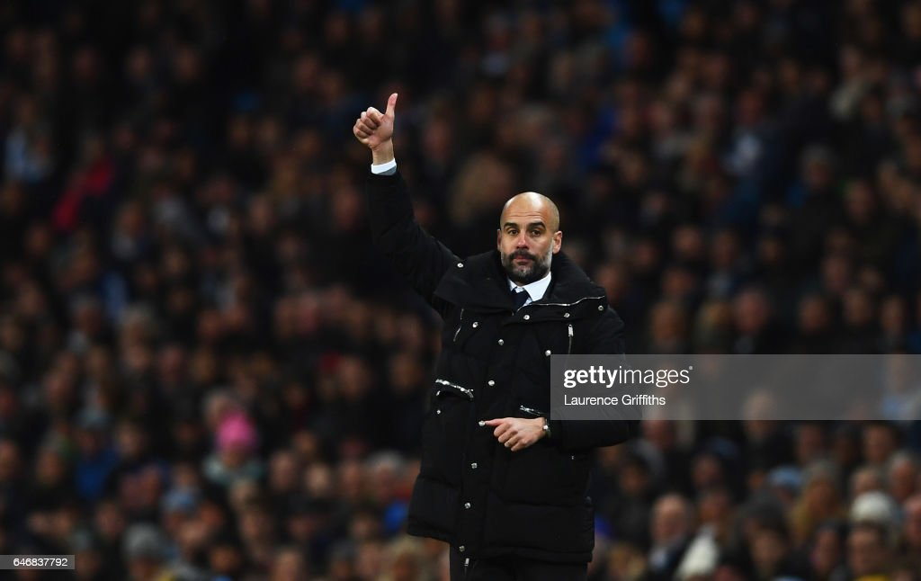 Josep Guardiola manager of Manchester City gives a thumbs up during The Emirates FA Cup Fifth Round Replay match between Manchester City and Huddersfield Town at Etihad Stadium on March 1, 2017 in Manchester, England.