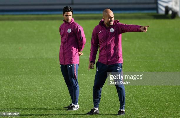 Josep Guardiola Manager of Manchester City gives his team instructions as Mikel Arteta Manchester City coach looks on during the Manchester City...