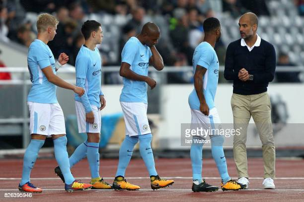 Josep Guardiola Manager of Manchester City gives his team instructions during a Pre Season Friendly between Manchester City and West Ham United at...