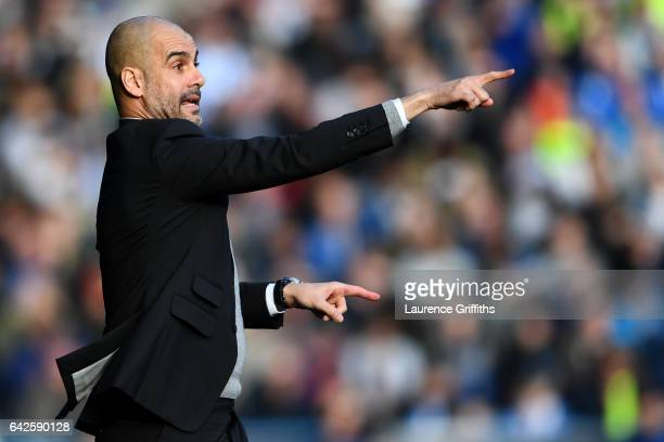 Josep Guardiola, Manager of Manchester City gives his team instructions during The Emirates FA Cup Fifth Round match between Huddersfield Town and...