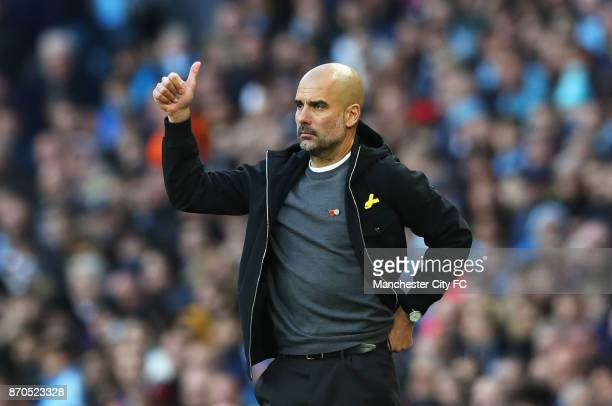 Josep Guardiola Manager of Manchester City gives his team instructions during the Premier League match between Manchester City and Arsenal at Etihad...