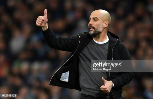 Josep Guardiola Manager of Manchester City gives his team instructions during the Premier League match between Manchester City and West Bromwich...