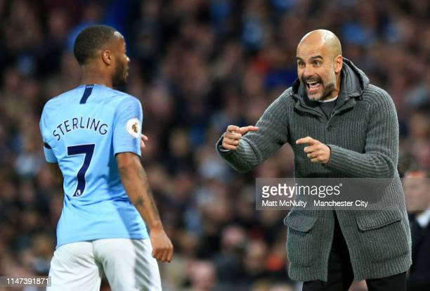 Josep Guardiola Manager of Manchester City gives instruction to Raheem Sterling during the Premier League match between Manchester City and Leicester...