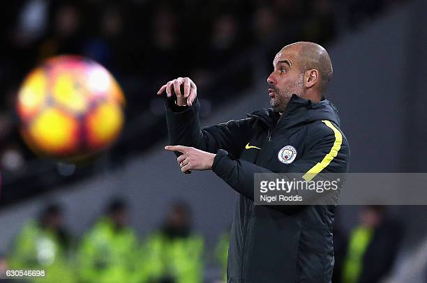 Josep Guardiola Manager of Manchester City gives instructions during the Premier League match between Hull City and Manchester City at KCOM Stadium...