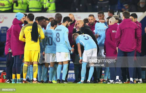 Josep Guardiola Manager of Manchester City gives instructions to players ahead of extra time during the Carabao Cup QuarterFinal match between...